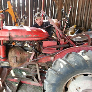 Tractor operator Pete Harry resuscitating our beloved 1942 McCormick Farmall model A